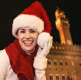 Woman in Christmas hat near Palazzo Vecchio having fun time Royalty Free Stock Images