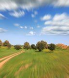 Trip on green fields on high speed. Magnificent cumulus clouds in the high spring sky.Trip on green fields on high speed Royalty Free Stock Photos