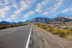 A trip at high speed   to the distant mountains Stock Photos