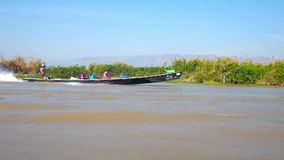 Trip on Inle lake, Myanmar. INLE LAKE, MYANMAR - FEBRUARY 18, 2018: The trip along the Inle lake in fast canoe with a view on other boats and villages on the stock video