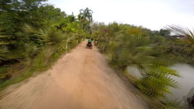 Trip through the jungle on ATV. Thailand stock video