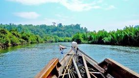 Kayak trip on Kangy river, Chaung Tha, Myanmar. The trip on old kayak among the lush mangrove forests on Kangy river, Chaung Tha, Myanmar stock footage