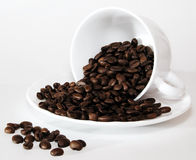 Trip-out. Coffee beans tripped out from a cup Stock Images