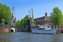 Trip through the picturesque canals of Amsterdam. Amsterdam, North Holland, The Netherlands - May 20 2018:  trip through the picturesque canals of Amsterdam royalty free stock image