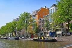 Trip through the picturesque canals of Amsterdam. Amsterdam, North Holland, The Netherlands - May 20 2018:  trip through the picturesque canals of Amsterdam royalty free stock photos