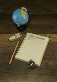 Trip Planner book with compass and globe model on wooden background Stock Photo