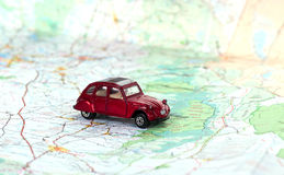 Trip planning. Toy car on a map Stock Photography