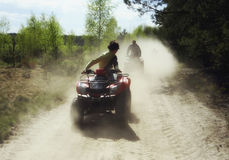 Trip on quads through the forest Royalty Free Stock Photos