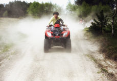 Trip on quads through the forest trails. Royalty Free Stock Photo
