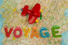 Trip theme. Voyage with kids background. Travel theme funny mood. Top view plane and letters Stock Photo