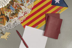 The trip to Catalonia. Copy space. Passports, fan, flag Royalty Free Stock Image