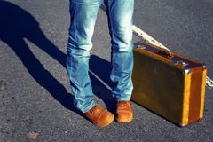 Trip to holiday.Travel to a week-end.Jeans, suitcase. Choice of Royalty Free Stock Photography
