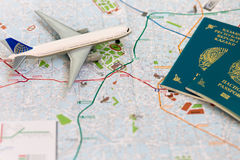 Trip to Italia- passport, plane and map of Milan. Travel, flight, international,  tourism, trip, map, around, passport, route, Italiy,  background, holiday Stock Photo
