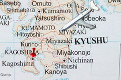 Trip to Kagoshima with toy airplane and push pin. On map of Japan Royalty Free Stock Photo