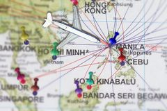 Trip to Manila with toy airplane and push pin  on map of The Phi. Lippines Stock Photos