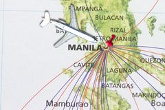 Trip to Manila with toy airplane and push pin. On map of The Philippines Stock Photos
