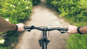 Trip to mountain bike from the first-person hand the wheel and road dust stock video