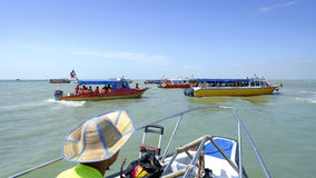 Trip to newly found Island of Sky Mirror   Malaysia. Selangor, Malaysia - May 28, 2017: A fleet of tourist boat arriving at the newly found sand bar island about Stock Photos