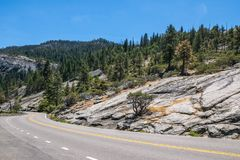Trip to the picturesque National Parks of the United States. Road to Yosemite. Trip to the Yosemite National Park. A winding road Stock Photography