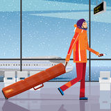Trip to the ski resort. Man walks through the airport with a snowboard - sport tourism concept Royalty Free Stock Image