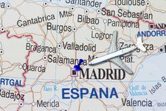 Trip to Spain with toy airplane. And push pin  on map of Europe Stock Photo