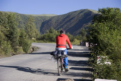 Trip to Tibet by bike. Each year ,about two thousand young Chinese boys and girls go vacation to Lhasa in Tibet of  western China  from Chengdu of Sichuan Royalty Free Stock Photo