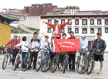 Trip to Tibet by bike. Ten young men celebrated their success of the long journey by bike from Chengdu to Lhasa in Stock Image
