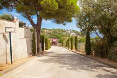 Trip to Tossa de Mar in Sapin. Two People walking with backpacks. Adventure travel Royalty Free Stock Photography