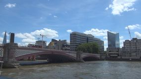 Trip with a Touristic Boat on Thames River Under a Bridge in London City stock video footage