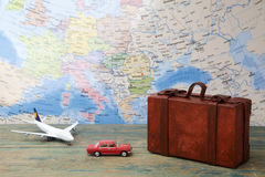 Trip or traveling by airplane concept. Miniature toy airplane and suitcases on map. Trip or traveling by airplane concept. Miniature toy airplane, car and Royalty Free Stock Photography