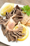 Tripe with lemon. Entrails of stomach of beef cooked in salted water with lemon juice called trippa tripe stock photo
