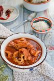 Tripe soup with tomatoes. Italian cuisine. Royalty Free Stock Photos