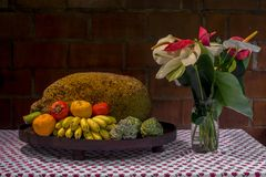 Tripical fruit arrangement and Anthurium on table royalty free stock photos