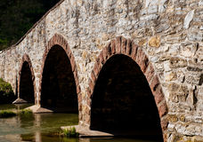 Triple arch stone bridge Royalty Free Stock Photography