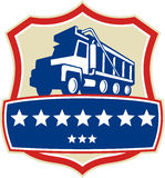 Triple Axle Dump Truck Stars Crest Retro. Illustration of a triple axle dump truck set inside shield crest with stars viewed from low angle done in retro style Royalty Free Stock Image