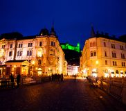 Triple Bridge in Ljubljana, Slovenia at night. Illuminated castle stock photography