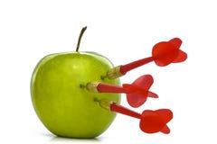 TRIPLE BULLSEYE 2. Three red darts-arrows hit a green apple Stock Photos