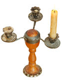 Triple candlesholder with one lighted candle Stock Images