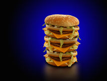 Triple cheese burger. With a blue and black background Stock Images
