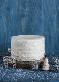 Triple chocolate layer cake. Milk, white and dark chocolate cake on wooden background. Royalty Free Stock Photo