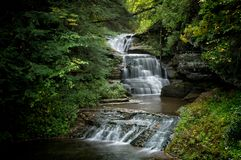Triple Falls. Located in Ithaca NY, this stunning trail takes you through Robert Treman State Park. There are several styles of waterfalls which are breathtaking stock photos