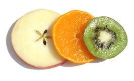 Triple fruit. Three sliced fruits - white background royalty free stock image