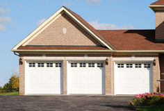 Triple Garage. Against a blue sky Royalty Free Stock Photo