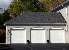 Triple Garage. Attached to a house Stock Photo