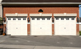 Triple Garage with flower pot Royalty Free Stock Photography