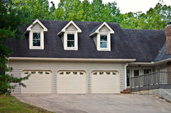 Triple Garage on a House stock images