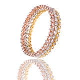 Triple gold bracelet. Woman bracelet made with colored gold pink, yellow, white gold and diamonds Royalty Free Stock Image