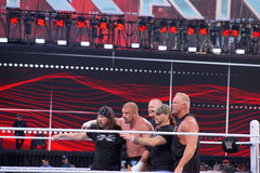 Triple H holds sledgehammer and Sting holds bat in ring during m Royalty Free Stock Image