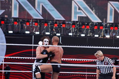Triple H knees Sting as they lock-up in ring during match Royalty Free Stock Photos