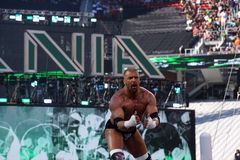Triple H points at himself as he stands on top of turnbuckles Stock Photo